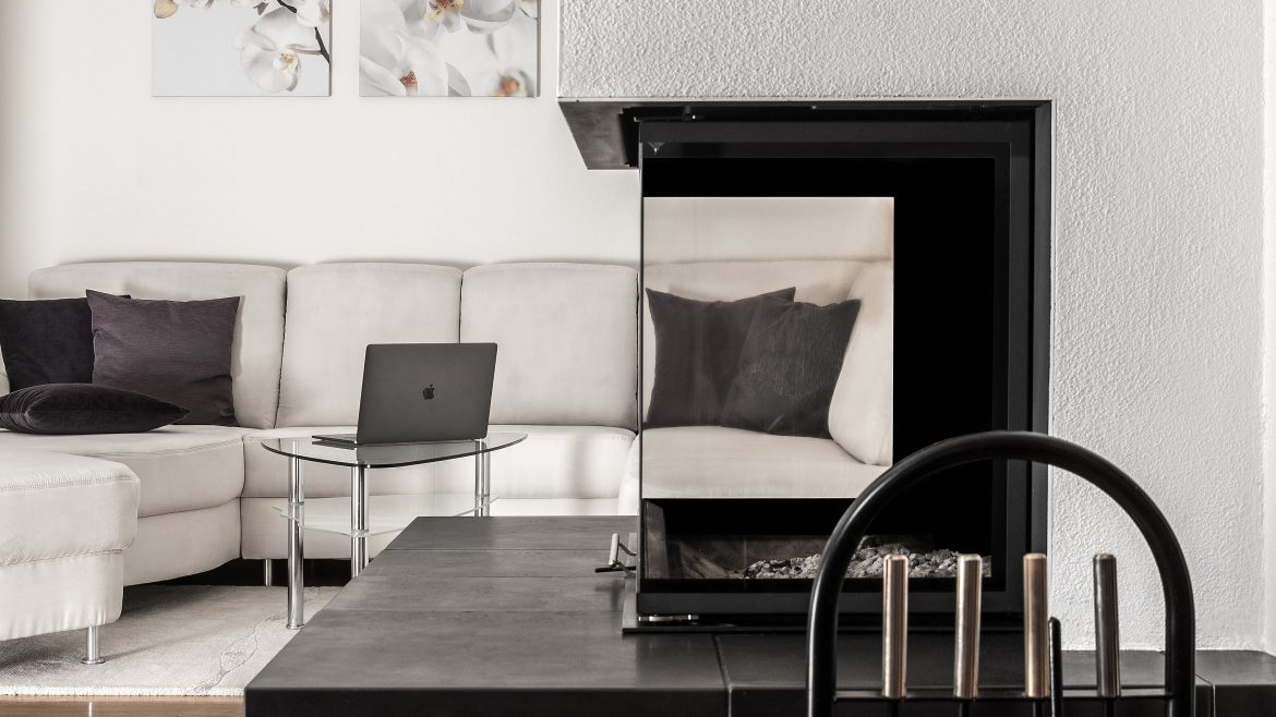 white sectional sofa and black table